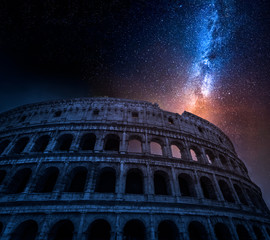 Fototapete - Stunning Colosseum in Rome at night with stars, Italy