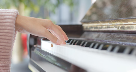 Female hands playing the piano