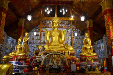 Golden Big Buddha statue for people praying and respect for blessing in ubosot at Wat Tha Sung in Uthai Thani, Thailand