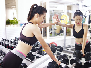young asian woman working out in gym