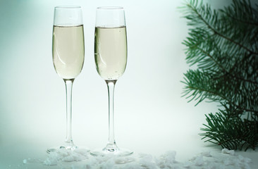 two glasses with champagne on Christmas background