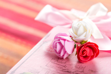 Gift in a pink box and roses