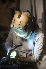 Professional mechanic welding motorbike pipe