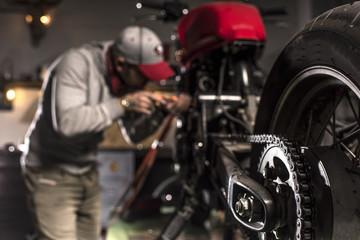 Motorbike mechanic repairing a motorbike