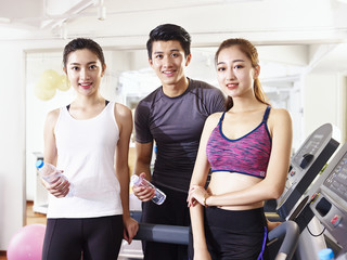 portrait of three young asian people in gym