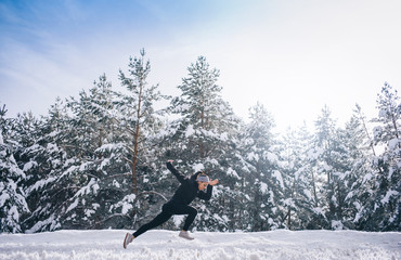Side view of young woman running in snowy landscape