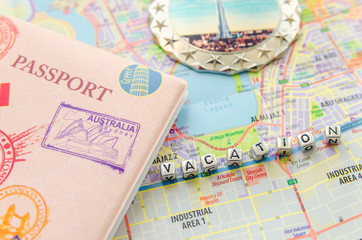 Word vacation and passport on city map UAE