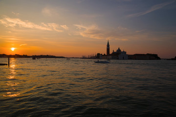 Sunrise in the bay of San Marco overlooking the Cathedral of San Giorgio Maggiore. Venice, Italy