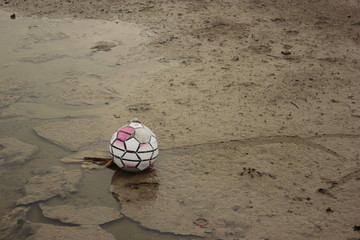 Old soccer ball on the ground