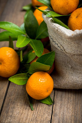 Mandarines on the rustic wooden background. Selective focus. Shallow depth of field.