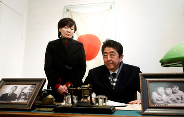 Japan's Prime Minister Shinzo Abe and his wife Akie Abe visit a former home of Chiune Sugihara, a Jew-saving Japanese diplomat, in Kaunas
