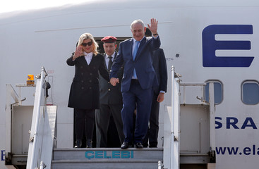 Israeli Prime Minister Benjamin Netanyahu and his wife Sara wave upon their arrival at Air Force Station Palam in New Delhi
