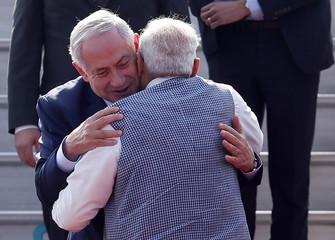 Israeli Prime Minister Benjamin Netanyahu and his Indian counterpart Narendra Modi hug each other upon Netanyahu's arrival at Air Force Station Palam in New Delhi