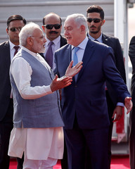 Israeli Prime Minister Benjamin Netanyahu is welcomed by his Indian counterpart Narendra Modi upon his arrival at Air Force Station Palam in New Delhi