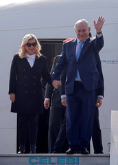 Israeli Prime Minister Benjamin Netanyahu and his wife Sara disembark from their plane upon their arrival at Air Force Station Palam in New Delhi
