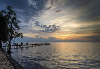tourists view sunset by pier in kep town cambodia coast