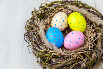 Spoed Fotobehang Tulp Colorful Easter egg in nest with rye on rustic wooden planks. Easter concept. Flat lay.