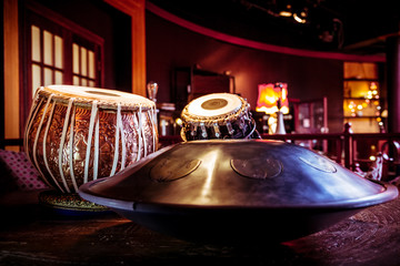ethnic musical instruments tabla and hang in the interior of the chill-out