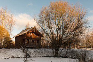 Traditional wooden Russian bath on the river bank with an ice-hole. Winter Russian landscape. Suzdal. An old wooden hut.