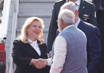 India's Prime Minister Narendra Modi shakes hand with Sara, wife of Israeli Prime Minister Benjamin Netanyahu, upon their arrival at Air Force Station Palam in New Delhi