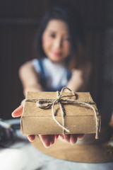 brown cardboard box in asian woman hand present and delivery ideas concept