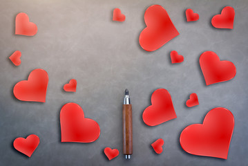 love ideas concept with wooden pencil and red heart shape on grey background valentine day metaphor