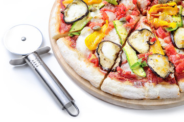 Pizza cutter with grilled vegetable pizza: tomato, mozzarella, eggplant, peppers, zucchini and capers