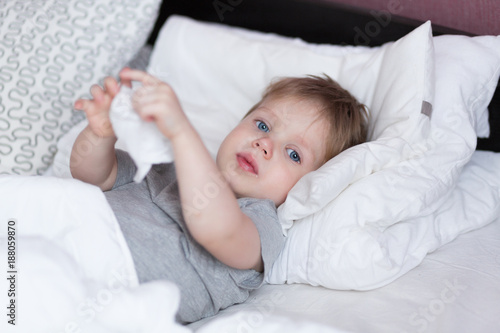 Little Kid Boy With Sore Throat Cough In The Bed Close Up