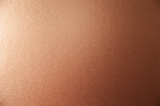 Texture of brown metallic paper background for design Christmas or New Year's party cards