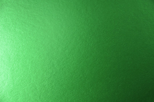 Texture of green metallic paper background for design Christmas or New Year's party cards