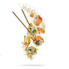 Flying pieces of sushi with wooden chopsticks, separated on white background.