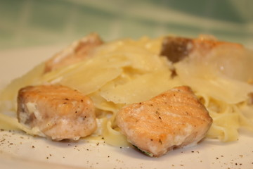 appetizing pieces of fish with noodles