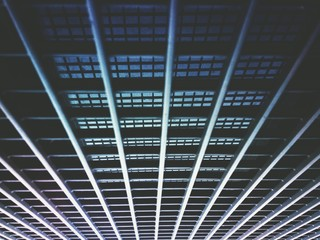 Abstract view of a metal security grill on a window