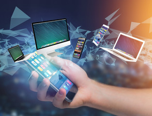 Computer and devices displayed on a futuristic interface - Multimedia and technology concept
