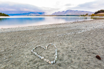 Love heart shape stones on beach