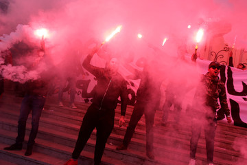 Men shout slogans during demonstrations on the seventh anniversary of the toppling of president Zine El-Abidine Ben Ali, in Tunis