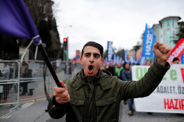 A demonstrator shouts slogans during a protest against the government's plan to extend the state of emergency imposed after the 2016 coup attempt for another three months, in Istanbul