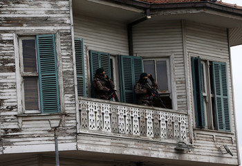 Members of police special forces stand guard during a protest against the government's plan to extend the state of emergency imposed after the 2016 coup attempt for another three months, in Istanbul