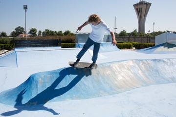 Skater doing kickflip on the ramp