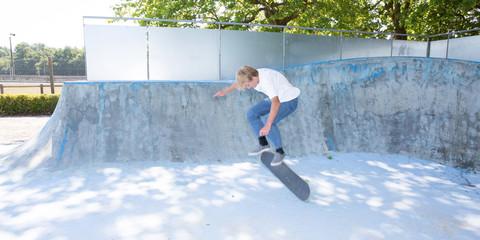 Young skater making a jump on Skatepark
