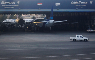 An EgyptAir maintenance and engineering hangar is pictured through the window of a plane in Cairo International Airport, Egypt