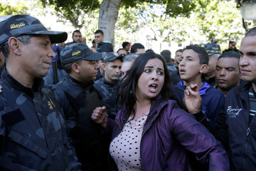 A woman shout slogans during demonstrations on the seventh anniversary of the toppling of president Zine El-Abidine Ben Ali, in Tunis