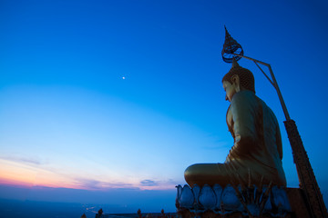 Buddha on the hill top in the early morning at Wat Tam Sau or Tiger cave temple at Krabi Thailand