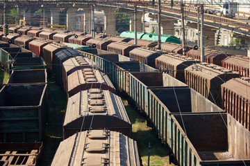 Perspective view cargo freight trains depot. Many freight train wagons.