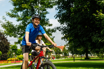 Healthy lifestyle - man riding bicycle in city park