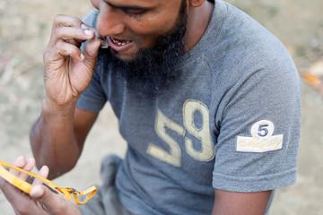 A Rohingya refugee trimmes his beard at Palong Khali camp, near Cox's Bazar