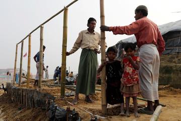 Rohingya refugees build a shelter at Palong Khali camp, near Cox's Bazar