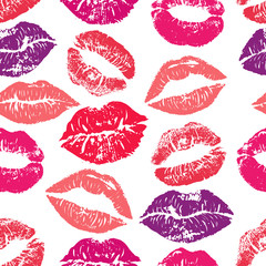 Seamless pattern with lipstick kisses. Colorful lips of red purple and pink shades isolated on a white background.fabric print, wrapping or romantic greeting card design. Print of lipstick kiss vector