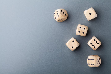 Top view of six wooden dice on table. Board game. Gambling devices.