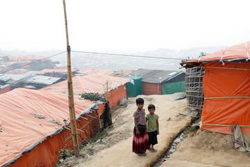 Rohingya refugee children walk in Palong Khali camp, near Cox's Bazar